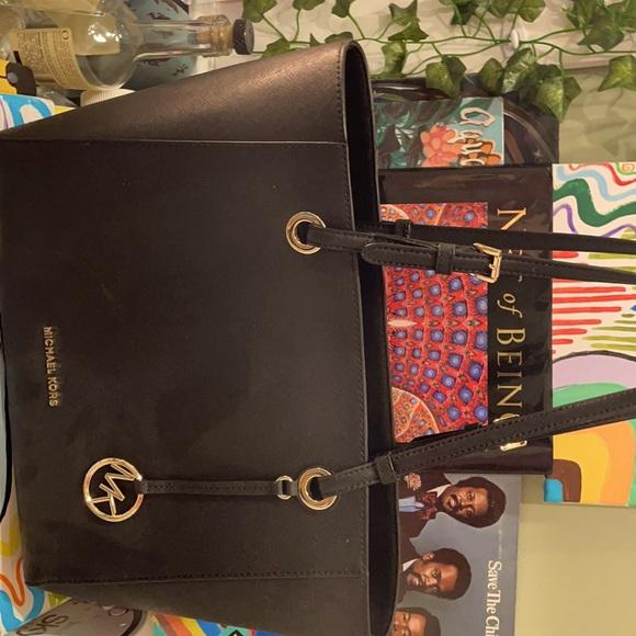 An all black Michael Kors bag